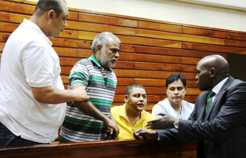 FILE PHOTO: (L-R) Baktash Akasha, Gulam Hussein, Ibrahim Akasha and Vijaygiri Goswami are briefed by their lawyer Cliff Ombeta at Mombasa Law Courts during a court appearance on drug-related charges in Mombasa February 17, 2015. REUTERS/Joseph Okanga