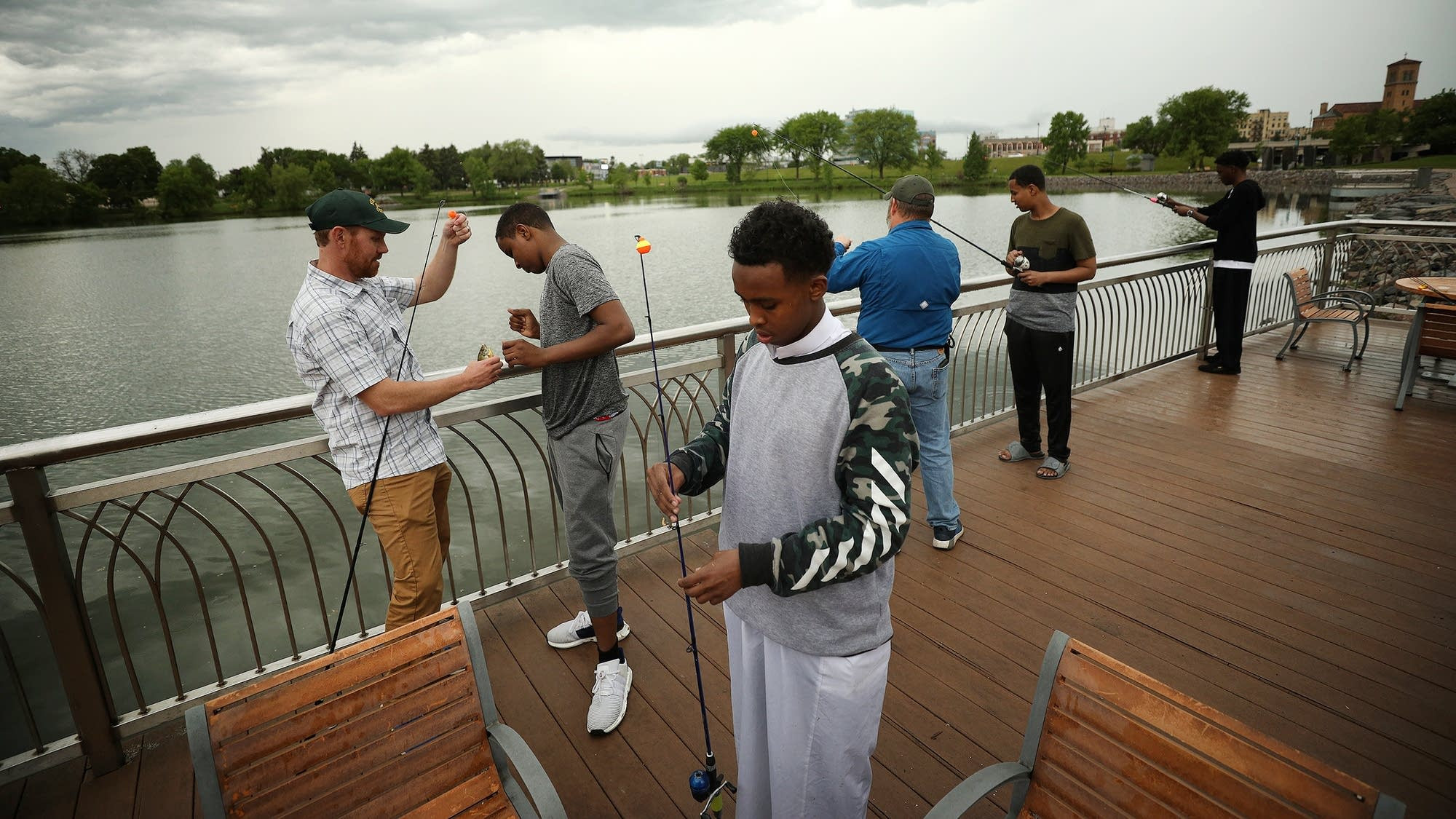 Members of the Somali community learn to bait a hook and cast a line during an event to celebrate Eid. <br>Paul Middlestaedt for MPR News