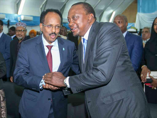 President Uhuru Kenyatta with Somali President Mohamed Abdullahi Farmaajo during Farmaajo's inauguration in Mogadishu, Somalia.