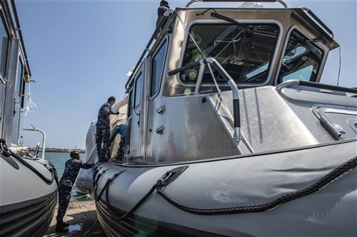 Members of the Djiboutian Navy inspect one of the new Defender patrol boats provided by the U.S. government, Feb. 22, 2020. The patrol boats combine an unmatched ability to conduct high-speed maneuvers in a compact deployable package. (U.S. Navy photo by Chief Mass Communication Specialist Elisandro Diaz)
