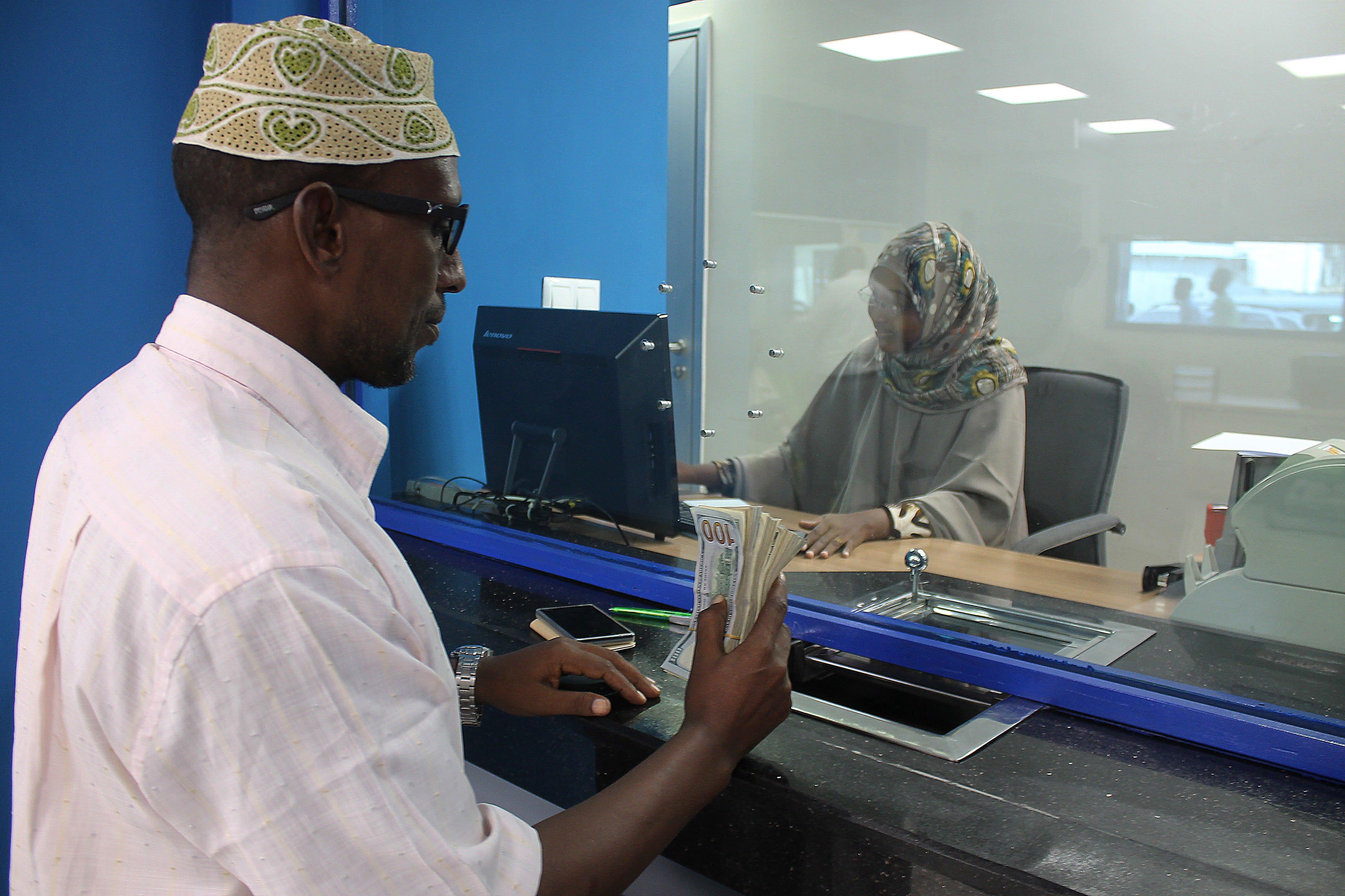 A customer at a bank in Mogadishu, Somalia on June 7, 2015.