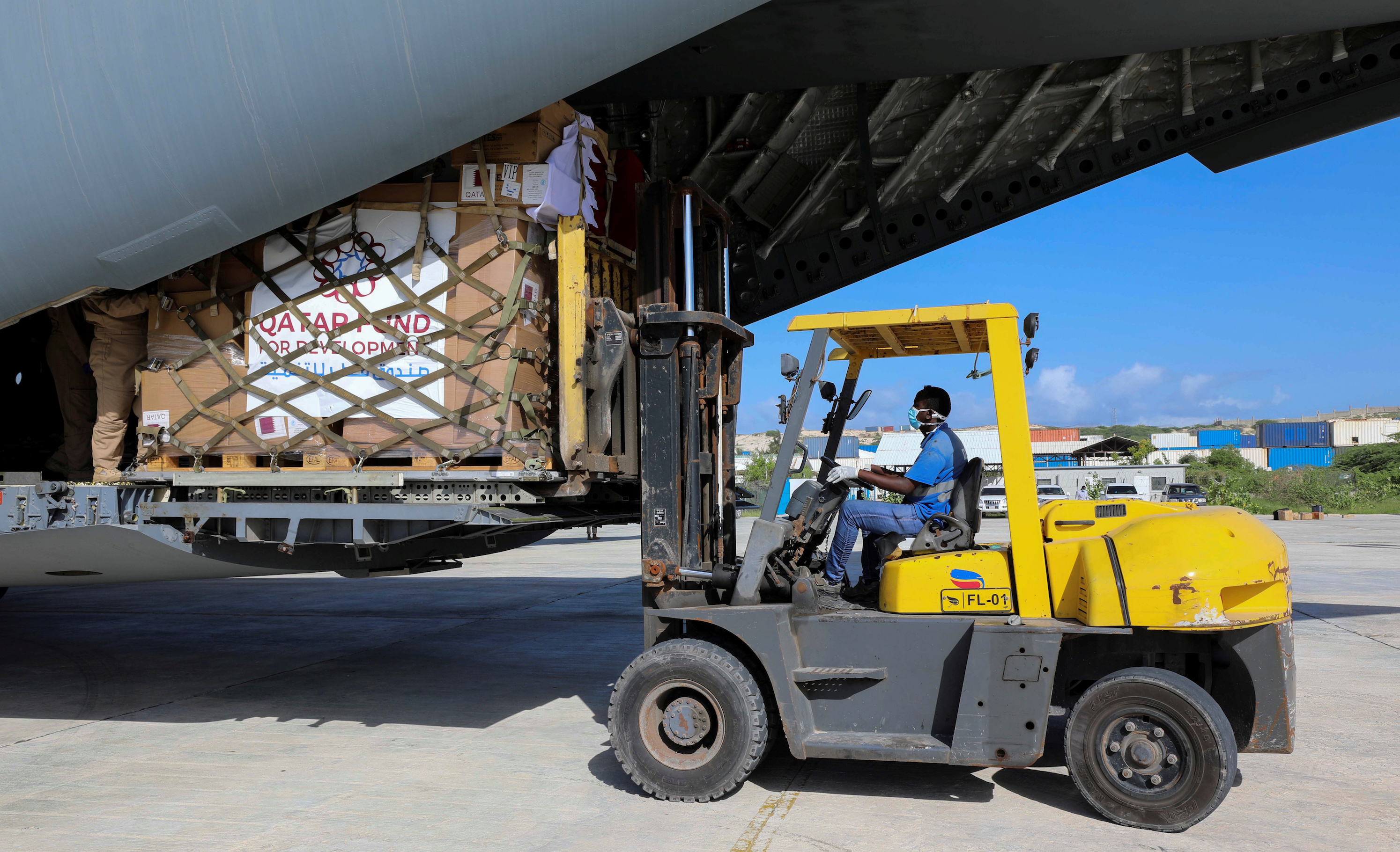A Somali worker unloads medical equipment from a Qatar military plane to help in containing the spread of the coronavirus disease (COVID-19) outbreak, at the Aden Abdulle International Airport in Mogadishu, Somalia May 16, 2020. REUTERS/Feisal Omar