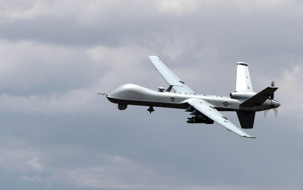 An MQ-9 Reaper remotely piloted aircraft performs aerial maneuvers over Creech Air Force Base, NV., June 25, 2015. (Senior Airman Cory D. Payne/U.S. Air Force)