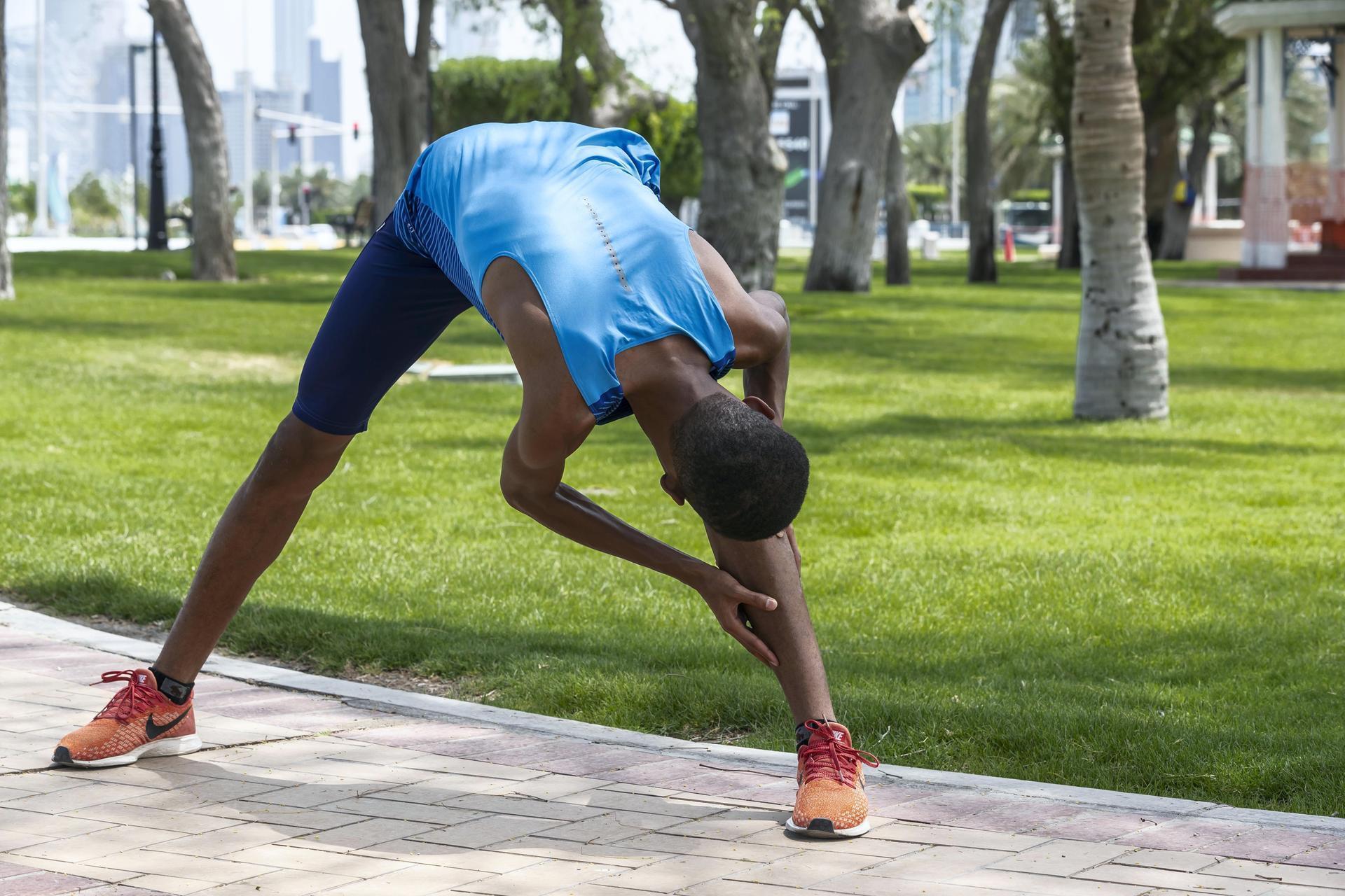 Abdulsalam Farah stretches before training.