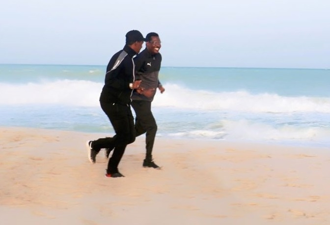 President Qoor Qoor, right, running on Hobyo beach after Saturday's rally (via Twitter)
