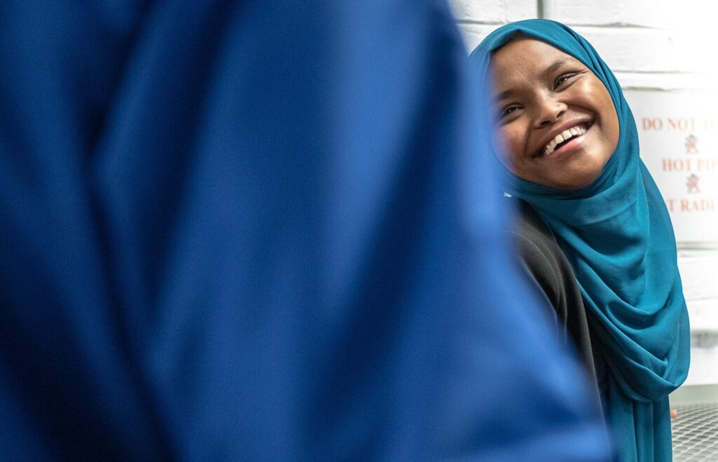 Safiya Khalid reacts after a voter exiting the poles wishes her luck at the entrance of the Lewiston Armory on Election Day, Nov. 5. Russ Dillingham/Sun Journal Buy this Photo