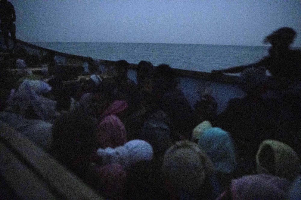 In this July 15, 2019 photo, smugglers ferry Ethiopian migrants in a boat at the uninhabited coast outside the town of Obock, the shore closest to Yemen, in Djibouti. According to the U.N.'s International Organization for Migration the number of women making the trip jumped from nearly 15,000 in 2018 to more than 22,000 in 2019. The number of girls had an enormous increase, quadrupling from 2,075 to 8,360. Despite the many risks – smugglers' exploitation, rape, hunger, drowning – they are undaunted. (AP Photo/Nariman El-Mofty)