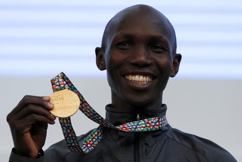 FILE PHOTO: Athletics - Tokyo Marathon 2017 - Tokyo, Japan - 26/02/17 - Gold medalist Wilson Kipsang of Kenya poses on podium. REUTERS/Toru Hanai
