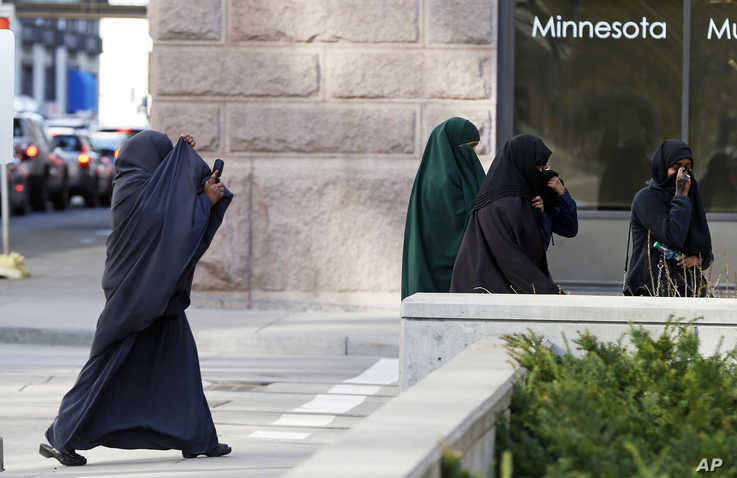 FILE -  Female members of Minnesota's Somali community cover their faces as they  arrive April 23, 2015, for a hearing in federal court in St. Paul,  Minnesota, in the case of several Minnesotans accused of plotting to  join jihadists.