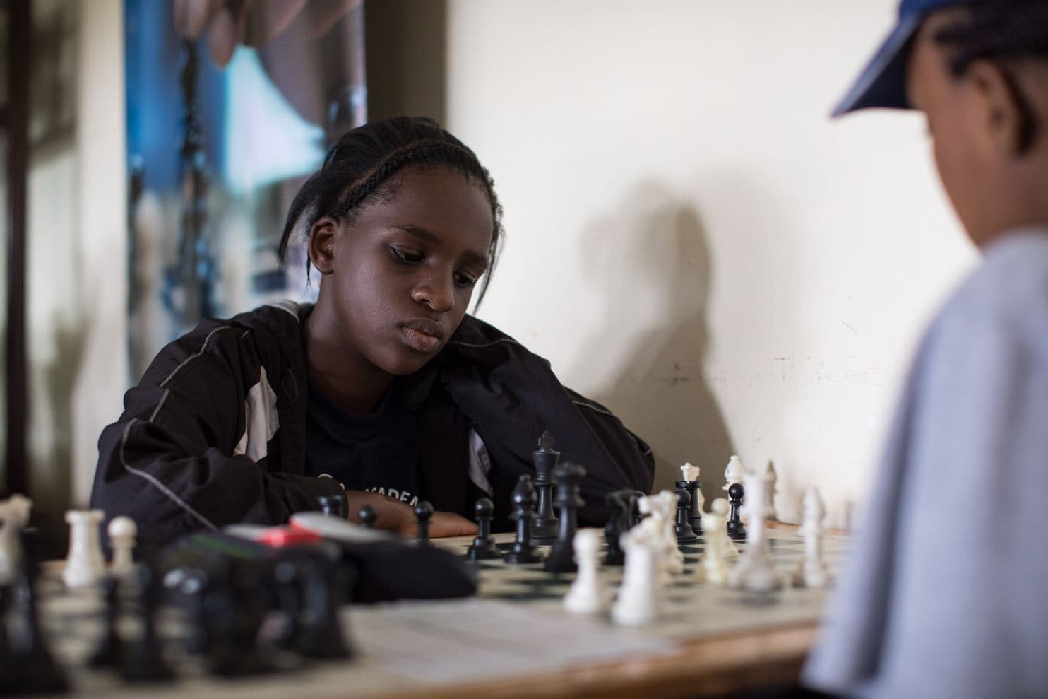 Sarah Momanyi plays a friendly game of chess at KCB Sports Club in Nairobi. The 13-year-old has become one of the most promising chess players in Kenya, attracting invitations from global championships as far as China. (Sarah Waiswa for The Washington Post)