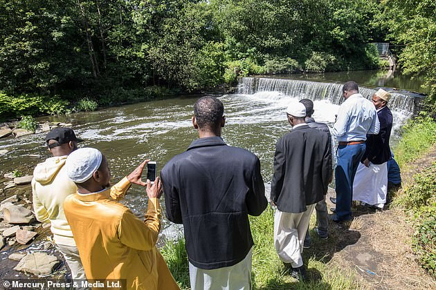 Shukri's family are pictured in June last year gathering at the River Irwell near Bury where she died to pay tribute to her