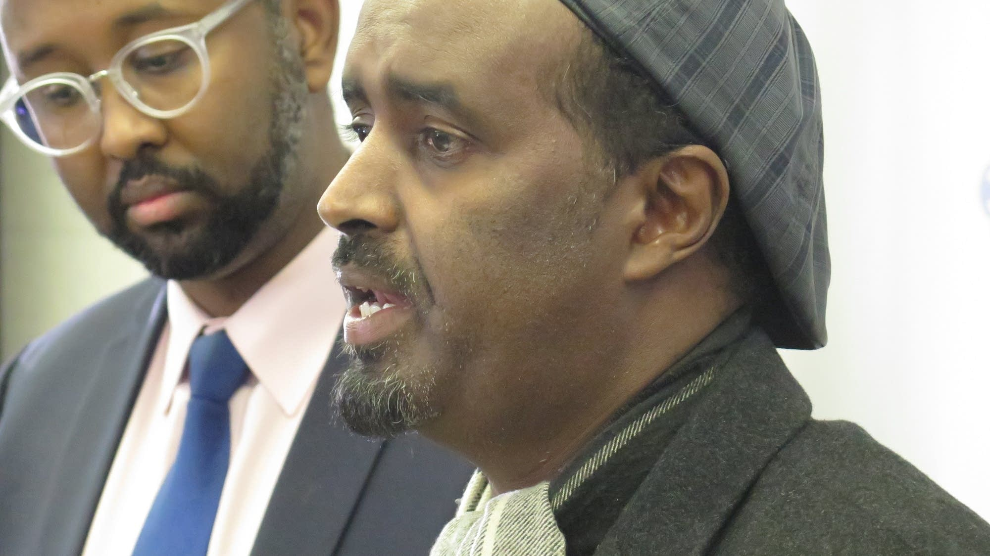 Haarun Galbayte, right, speaks to reporters alongside Jaylani Hussein, executive director of the Minnesota chapter of the Council on American-Islamic Relations in Minneapolis on Thursday. Matt Sepic | MPR News