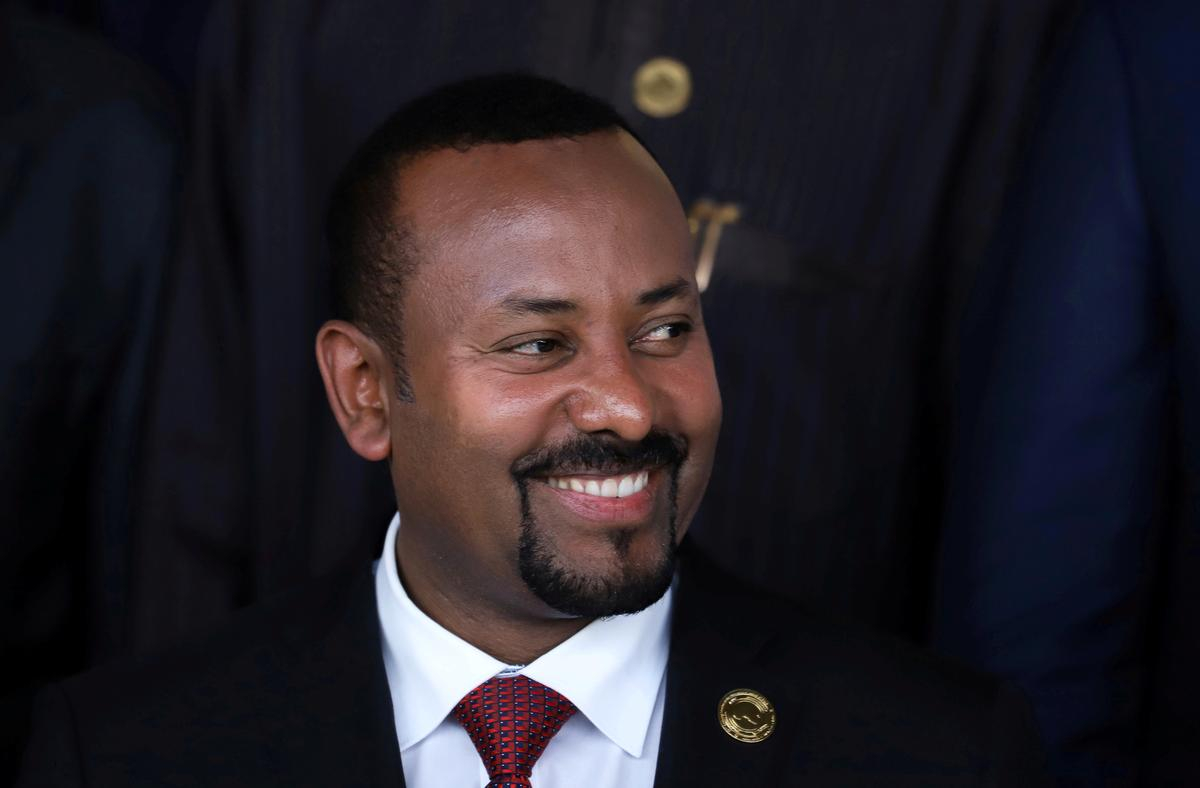 FILE PHOTO: Ethiopian Prime Minister Abiy Ahmed smiles during an African Union (AU) summit meeting in Addis Ababa, Ethiopia, February 9, 2020. REUTERS/Tiksa Negeri