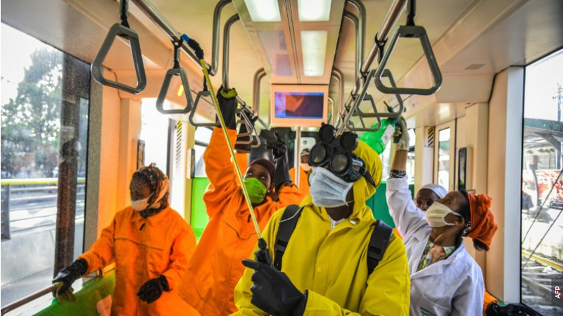 Cleaning staff disinfect a metro carriage in Addis Ababa .Ethiopia announced its first COVID-19 death Sunday.PHOTO/AFP