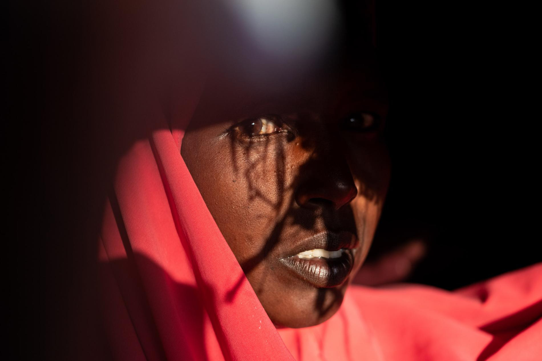 This portrait of Rahma Hassan Mahmoud was taken at the Burao IDP camp. In 2016, a severe drought killed her herd of 300 sheep and goats and 20 camels, forcing Rahma, her husband, and 12 children to abandon their village.