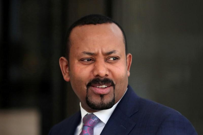 FILE PHOTO: Ethiopia's Prime Minister Abiy Ahmed waits for meeting to start in Addis Ababa, Ethiopia December 7, 2019. REUTERS/Tiksa Negeri