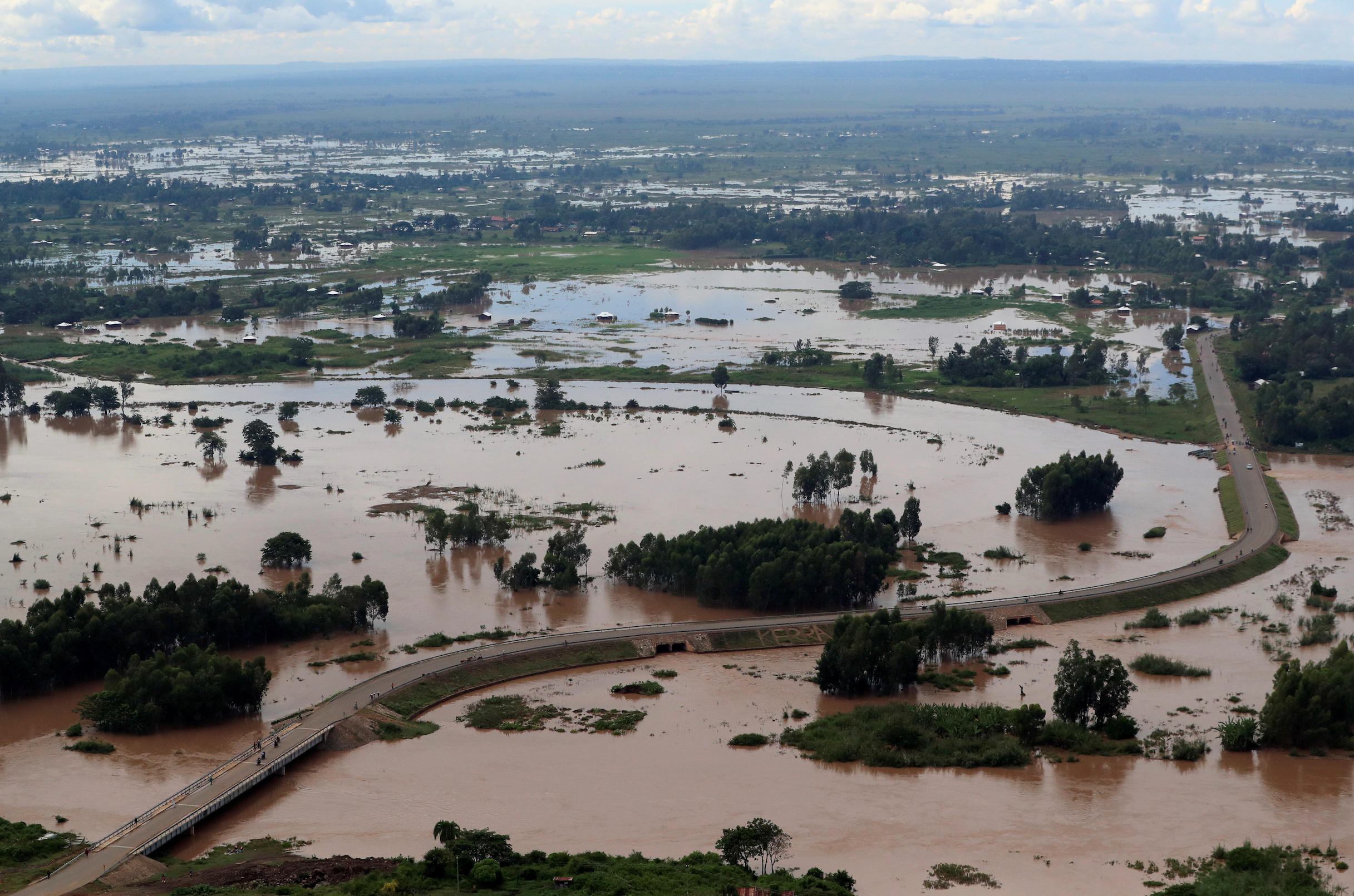 FILE PHOTO: An aerial view shows flood waters near the Sigiri bridge, after River Nzoia burst its banks and due to heavy rainfall and the backflow from Lake Victoria, in Budalangi within Busia County, Kenya May 3, 2020. REUTERS/Thomas Mukoya/File Photo