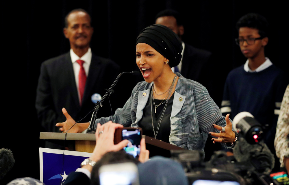 And in the Midwest a onetime Somali refugee, Ilhan Omar, and Rashida Tlaib, who is the daughter of Palestinian immigrants, shared the historic distinction of becoming the first two Muslim women elected to the US Congress. (Eric Miller/Reuters)