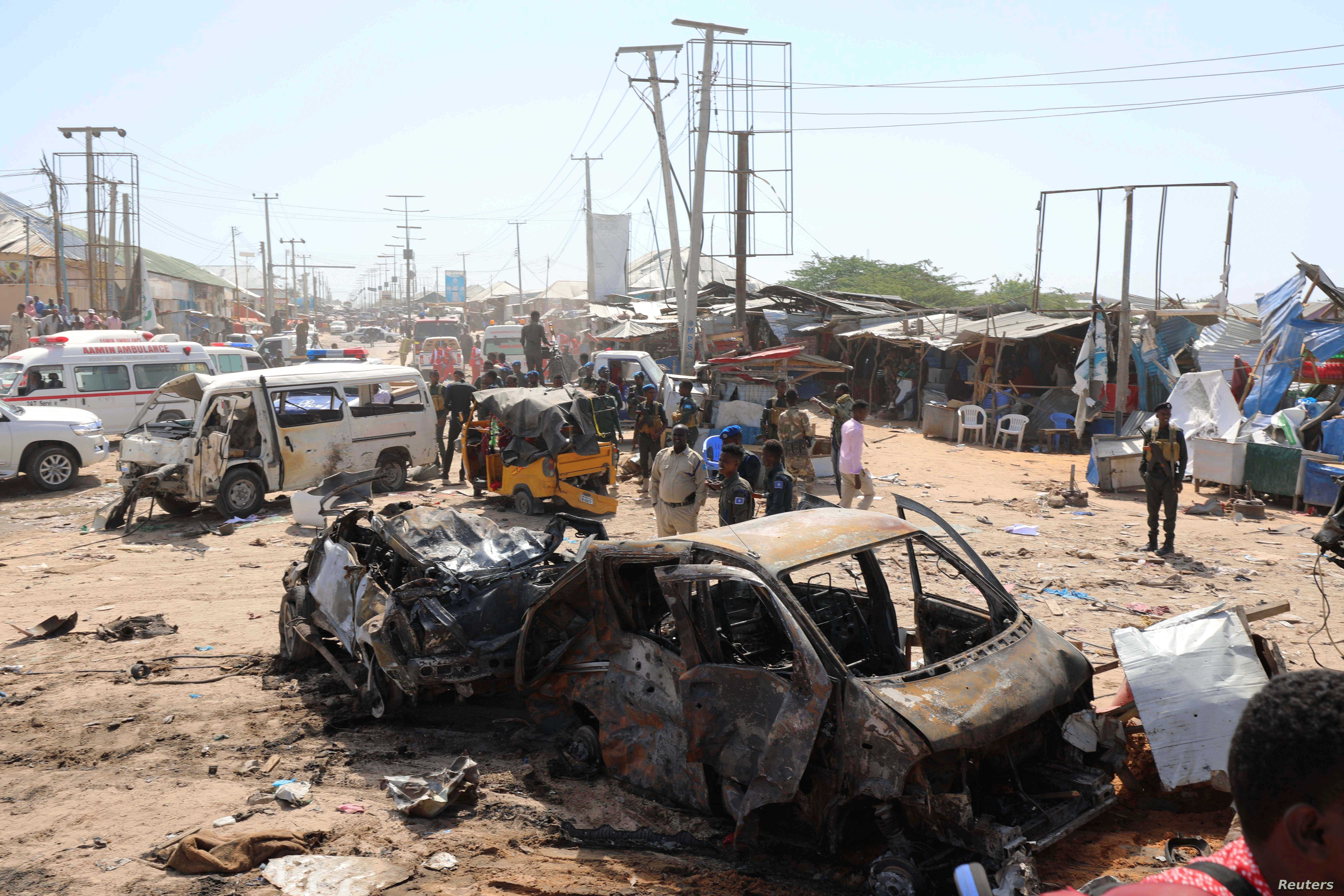 FILE - A general view shows the scene of a car bomb explosion at a checkpoint in Mogadishu, Somalia, Dec. 28, 2019.