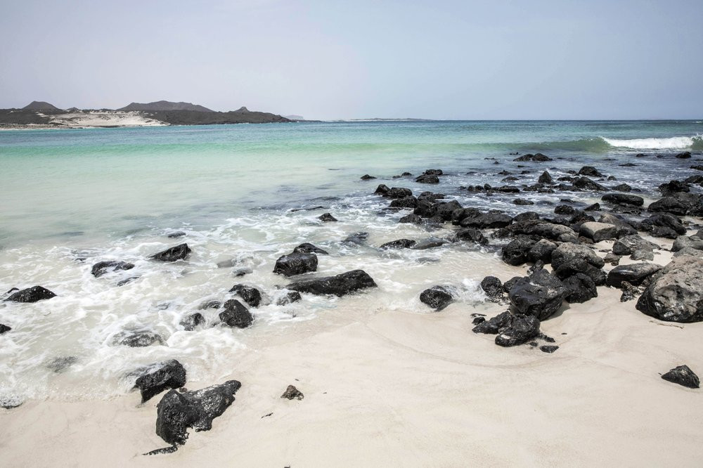 This July 27, 2019 photo shows the shores of Bir Ali where migrants from Bosaso, Somalia arrive, in Shabwa, Yemen. According to the U.N.'s International Organization for Migration the number of women making the trip jumped from nearly 15,000 in 2018 to more than 22,000 in 2019. (AP Photo/Nariman El-Mofty)