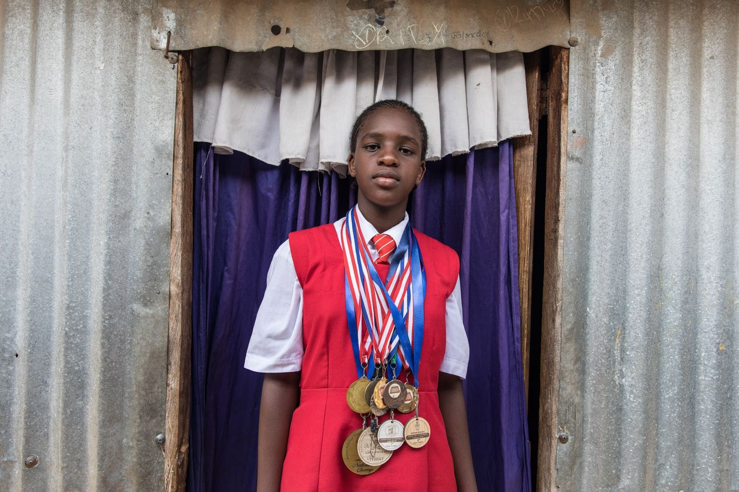 Sarah Momanyi has won a large collection of medals in various chess tournaments. (Sarah Waiswa for The Washington Post)