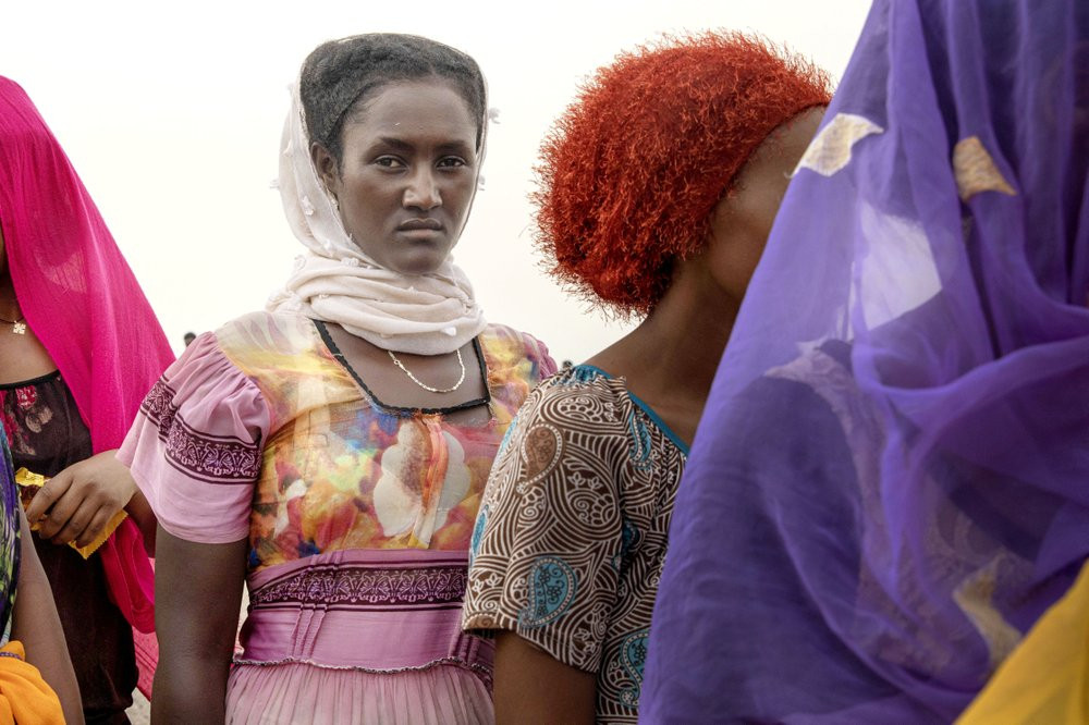 In this July 25, 2019 photo, Ethiopian Tigray migrants stand in lines as they are counted by smugglers after arriving to the coastal village of Ras al-Ara from Djibouti, in Lahj, Yemen. According to the U.N.'s International Organization for Migration the number of women making the trip jumped from nearly 15,000 in 2018 to more than 22,000 in 2019. The number of girls had an enormous increase, quadrupling from 2,075 to 8,360. Despite the many risks – smugglers' exploitation, hunger, drowning – they are undaunted. (AP Photo/Nariman El-Mofty)